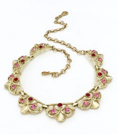 Coro Scallop Shell Necklace, Pink and Red Chaton Rhinestones, Eight Scalloped Links, Gold Tone Metal, Designer Signed, Special Occasion by Vintageimagine on Etsy https://www.etsy.com/listing/466883105/coro-scallop-shell-necklace-pink-and-red