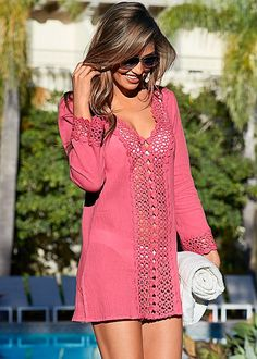 Sunburn? No thanks! Stay covered in this chic cover-up! Venus open crochet trimmed tunic.