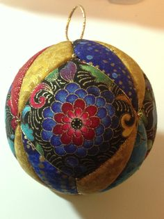 Kimekome patchwork ornament in blues, gold, red & green