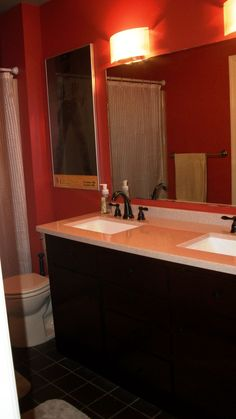 Cream Floor Tiles, Red Walls, Black Cupboards, Same Countertop And Faucet  Fixtures,