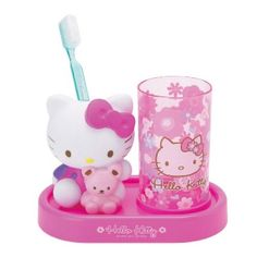 Hello Kitty toothbrush holder set. Saw one similar at Walmart; They actually had an entire bathroom set! Everything sold separately, of course. All together, should cost about $100 or so. I will eventually have an all out Hello Kitty bathroom; Bank on it, bitch. xD