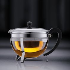 The CHAMBORD® teapot by BODUM combines design, quality and functionality of the finest caliber. The comfortable plastic handle does not conduct heat, allowing you to pour hot tea without burning yourself. This teapot includes everything you need for an en Shops, Chambord, French Press, Ceramic Pottery, Tea Pots, Coffee Maker, Kitchen Appliances, Dishes, Tableware