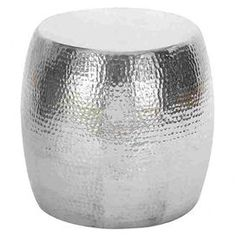 "Drum-shaped metal stool with hammered details.   Product: Stool Construction Material: Aluminum  Color: Silver  Features:   Knurling spots Beautiful hammered detail Offers extra guest seating or a convenient side table    Dimensions: 16"" H x 14"" Diameter"