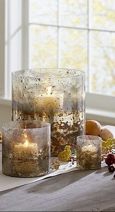 Gorgeous with the look of burnished metal, these striking textured glass candle holders are hand sprayed with silver and gold paint. Each one is uniquely textured and colored. Indoor Lanterns, Lanterns Decor, Silver Candle Holders, Hurricane Candle Holders, 3d Texture, Glass Texture, Mercury Glass Decor, Antique Bottles, Vintage Bottles