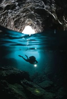 People Diving Underwater At Sea, Ocean, Cave. The sea is incredibly clear, which is ideal for snorkeling. Cave Diving is challenging sport and it is very dangerous and require top skills. Under The Water, Under The Sea, Cave Diving, Scuba Diving, Underwater Caves, The Ocean, Ocean Beach, Green Ocean, Laguna Beach