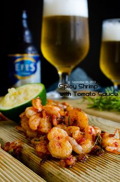 Spicy shrimp stir fry is a great appetizer with cold beer. It's flavored with chili, isot, garlic and rosemary and served with tomato sauce.