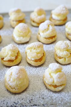 Pumpkin Pie Cream Puffs - A light and fluffy French treat with a fall twist! A simple puff pastry filled with pumpkin pie filling and a maple whipped cream!