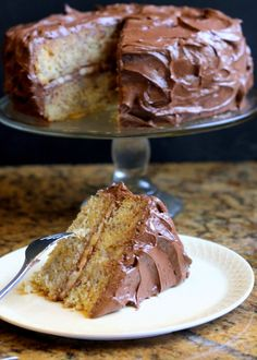 This recipe for Banana Layer Cake with Chocolate Cream Cheese Frosting makes one of the moistest banana cakes around - definitely not to be confused with banana bread. The chocolate cream cheese frosting makes it even more decadent!