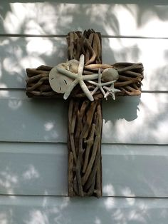 Driftwood Seashell Cross/ Driftwood Starfish by My Honeypickles @Sky T  dont you think this would fit perfect in my house!! I have the shells I just need to do the stick part