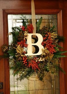101 Cool Fall Wreath Ideas-I like the letter in teh middle of this wreath
