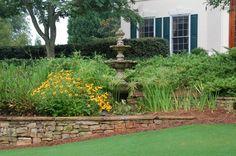 tiered fountain hidden among plants