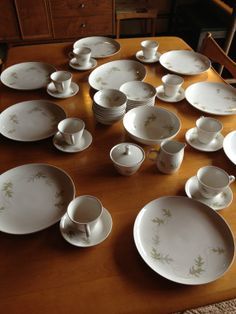 """Franciscan White Stoneware Whirl-A-Gig 44 Piece Set This beautiful 44 piece set is in amazing condition! Perfect for fall with it's pretty oak leaves of different shades of green and gray. 8 Dinner Plates - 10"""" 8 Dessert Plates - 6"""" 8 Fruit Bowls - 5"""" 8 Cups 8 Saucers - 5.5"""" 1 Oval Platter - 13"""" 1 Round Serving Bowl - 8.25"""" 1 Sugar Bowl with Lid - 4.5"""" tall 1 Creamer Pitcher - 4"""" tall"""