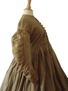 Gingham Silk Maternity Dress Pre Civil War Era c 1850's  Museum deaccession from Brooklyn Museum of Art, New York and has the original tags with museum's acquisition numbers and date.  Wonderful pre Civil War era silk maternity dress.  Brown and white gingham with replaced faux wood buttons.  One piece dress.  Hidden pocket and drawstring waist.   Measurements:   Bust:  35 inches, Waist:  36 inches