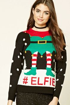 "A ribbed knit sweater featuring a ""#Elfie"" and elf graphic on front, metal bell accents, a round neckline, and long sleeves."