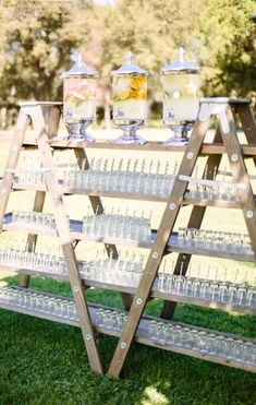 a large wedding drink bar made of a couple of ladders and drinks in sheer tanks flowers decoration hanging Top 20 Vintage Wooden Ladder Wedding Decor Ideas Ladder Wedding, Farm Wedding, Diy Wedding, Wedding Favors, Wedding Reception, Wedding Day, Wedding Backyard, Wedding Vintage, Wedding Invitations
