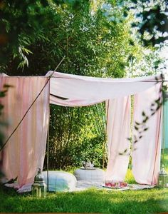 I love this makeshift tent, with cozy blankets and pillows!