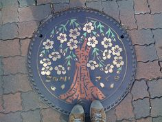 Painted manhole with Sakura tree :-) by Olis Olois, via Flickr