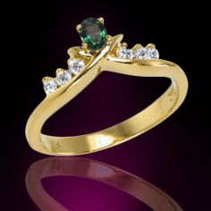 Set in 18K gold, this ring features one oval shape natural alexandrite accompanied by an assortment of sparkling white diamonds.
