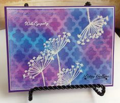 """By Patsy Collins. Stamp Hero Arts """"Silhouette Spray"""" and sentiment in VersaMark. Heat emboss with white powder. Sponge background. Stamp text in spots. Lay """"Lattice"""" stencil (Heidi Swapp/Pink Paislee) on piece. Sponge through stencil. Lift stencil. Buff."""