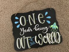Hand lettered chalk board sign for baby's first birthday