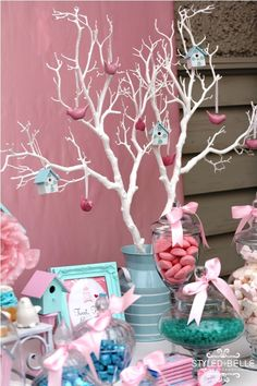 love the tree- paint a magnolia branch white, put in vase on food table. Add party gifts in little bags on string to branches.