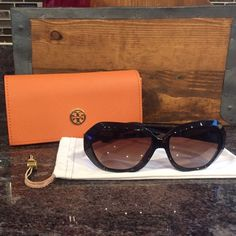 Tory Burch Sunglasses Gently Worn Authentic TY9021 Tory Burch Sunglasses in Tortoise/Brown. Some wear noted inside arms- writing is worn off, very small scratch on outer edge of Right eye lens. (Unable to get pic of scratch bc it's so small). No other scratches noted on frames or lenses. Comes with cloth and hard case. No trades please..  Tory Burch Accessories Sunglasses