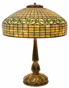 Dichroic swirling lemon leaf table lamp with geometric shade.