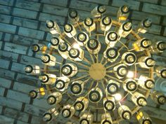 looking up at a tequila bottle chandelier