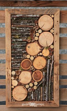 Bug hotel fence art - Natural and found elements such as branches, seed heads, bamboo, and moss are set in a wooden frame as four-season art. With materials collected from the garden it looks right at home!