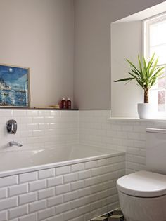 White Brick Wall Tiles Have Been Continued Around The Side Of The Bath  Which Keeps The Design Of This Family Bathroom Sharp And Focused.