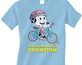 Light Blue Children's KICKER RIDES A BIKE Short Sleeve T-Shirt, Visit:  MySporties.com
