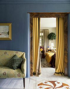 For the entrance hall of a Pennsylvania farmhouse, designer Jeffrey Bilhuber chose a regal blue (Benjamin Moore's Van Deusen Blue), which he based on a color he had seen at Mount Vernon. A 1920s settee is covered in Le Gracieux's hand-blocked 'Kirachi' damask