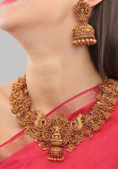 Gold Plated South Indian Lakshmi Temple Jewelry Necklace Set/ Gold plated Temple work Choker and Jhumka Earrings Set - Anita Mahauti - internationally inspired Gold Jhumka Earrings, Indian Jewelry Earrings, Indian Jewelry Sets, Jewelry Design Earrings, Gold Earrings Designs, Gold Jewelry, Indian Gold Necklace Designs, Jewelry Necklaces, Indian Necklace