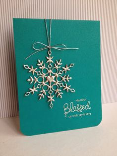 lhandmade card ... Silver Snowflake on teal card ... luv the colors ... die cut snowflake double heat embossed with silver powder ... clean and simple ... beautiful card!!