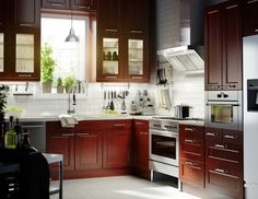 RAMSJÖ drawer fronts in red-brown can add a beautiful splash of natural colour in any kitchen.