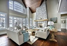 Windows. Open space. Stone fireplace. Neutral floor