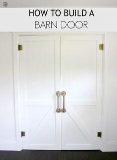 How to build a Barn Door. A full DIY tutorial on how to build an awesome Barn Door for your house on dreambookdesign.com