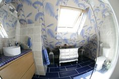 A Fish-eye view of stylish natural stone tile on the backsplash, and deep blue tiling on the floor. Bathroom Photos, Tiling, Stone Tiles, Amazing Bathrooms, Deep Blue, Backsplash, Loft, Fish, Eye