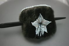 What a cute little hairpiece! The flower seems so icy & delicate. The fur is sealskin, appropriately & ethically harvested by the artist's tribe.  Forever midnight star by EskimoScrybe (Nasugraq), an Inupiaq Eskimo of the Tikigaqmiut in Alaska.