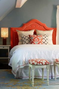 "Canadian Designers Celebrate ~  mix of modern graphics, upholstered nailhead stools and upholstered headboard. the ""pulled together"" look ~ pillow picks up wall and rug color. Lamp picks up nailheads and rug, headboard has white piping while comforter is opposite, ..."