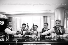 Groomsmen poses I love all the guys sitting at the bar together and i LOVE that the groom is the only one with a mimosa and the rest of the guys have beers! lol www.lovetreeblog.ca
