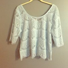 Lace crop top Very cute light blue lace top. Quarter length sleeves. More of a longer crop top. See through as shown in last picture. Zips up the back. Wet Seal Tops Crop Tops