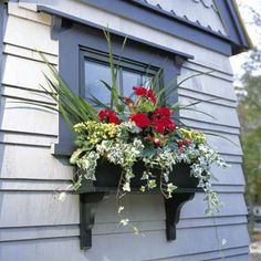 I never thought about adding a window flower box to our storage building.  Nice!  We could make it match the house - especially if we move the building closer to the house.