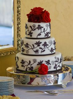 Black and white piped flower/scroll wedding cake with red roses from www.justsimplydelicious.com