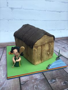 Star rower modelled Kawaii style standing in front of boathouse cake. Cheeky little crab behind because our star rower because she caught one at Henley Regatta 2016. Boathouse covered using Karen Davies Rustic driftwood mould & airbrushed.