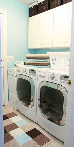 Laundry room makeover...love what she did here, including color matching the blue in the rug with the blue paint on the walls. Like everything else about this room, too!