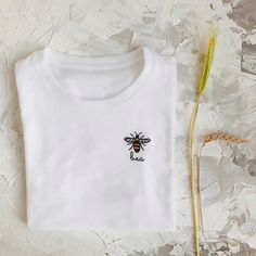 My grandpa is a beekeeper and I always loved this tiny hard workers! This t-shirt features little cute bee embroidered by hand onto t-shirt. Text can be easily customized! DETAILS: All embroidery is done by hand in 100% cotton thread. T-shirts are 100% cotton. The shirts are very soft and