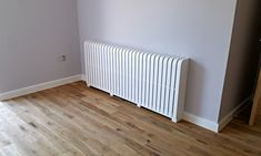 Cool radiator cover: modern by cool radiators? it's covered! Modern Radiator Cover, Home Radiators, Painted Radiator, Designer Radiator, Apartment Furniture, Wooden Flooring, Real Wood, White Paints, Cabana