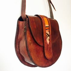 A personal favorite from my Etsy shop https://www.etsy.com/listing/257656355/rug-embellished-leather-crossbody