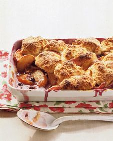 Fresh peaches and blueberries are baked beneath a fluffy layer of vanilla-cream biscuits. The tops are brushed with heavy cream and sprinkled with sanding sugar for a crispy-sweet crunch.
